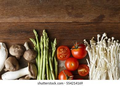 Fresh vegetable cooking ingredients on rustic wooden table