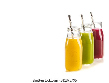 Fresh vegetable and fruit smoothies isolated on white with copy-space