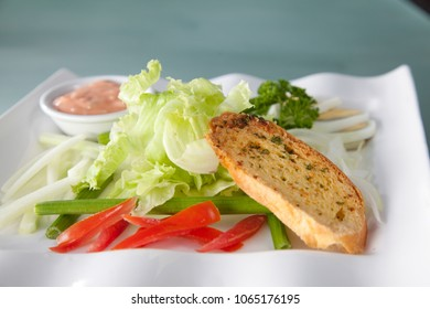 fresh vegetable lettuce salad with french bread diet food