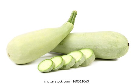 Fresh vegetable marrow and slices. Isolated on a white background.