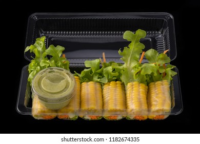 Fresh vegetable noodle spring roll with sauce in box, Salad roll, On a black background. Diet or cook concept.