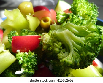 a fresh vegetable salad with brocoli, pepper and olives