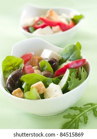 Fresh vegetable salad with calamata olives, crouton and cheese. Selective focus