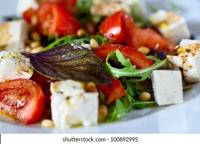 Fresh vegetable salad with cedar nuts