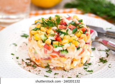 Fresh vegetable salad with corn, pepper, crab, cucumber, eggs and mayonnaise
