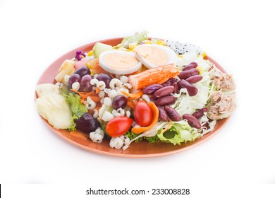 Fresh vegetable salad and salad cream  isolated on white background