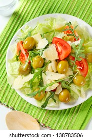 Fresh vegetable salad with green olives and Parmesan