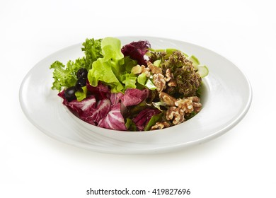 Fresh Vegetable Salad on white plate, side view, isolated on white
