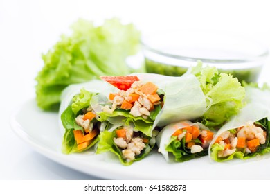 Fresh vegetable salad roll in noodle tube isolated on white background