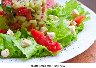 Fresh vegetable salad with tomato and cucumber