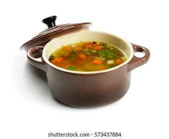 Fresh vegetable soup in pan on white background