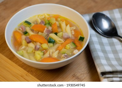Fresh Vegetable soup and pasta in a white bowl