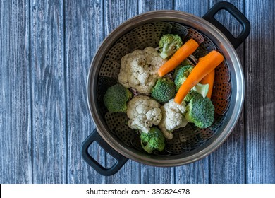 Fresh vegetables against wooden table background