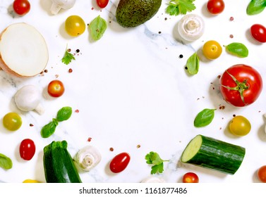 Fresh vegetables, arrangement on a white marble background with copy space.