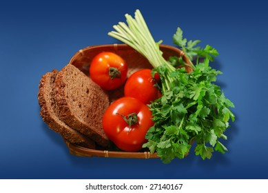fresh vegetables in basket. tomato, parsley, bread. isolated with clipping path