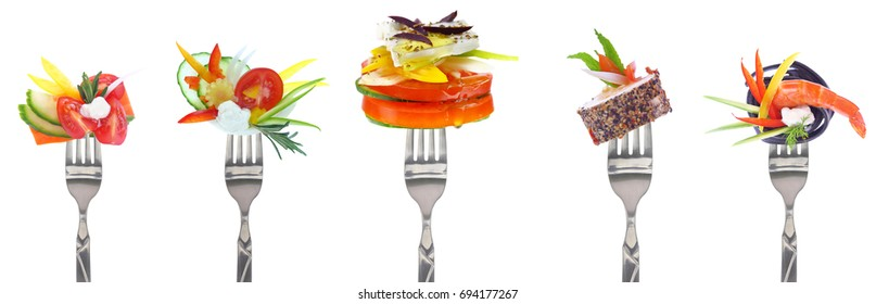 Fresh vegetables and cheeses on forks isolated on white background