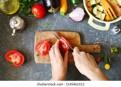 Fresh vegetables and cooking pan on table, top view. Healthy food and eating concept. Preparing for vegetable ragout, top view
