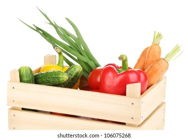 Fresh vegetables in crate isolated on white