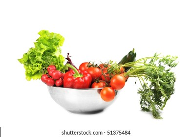 fresh vegetables in  dish.Included are  tomatoes, carrots,radish, cucumber, onions