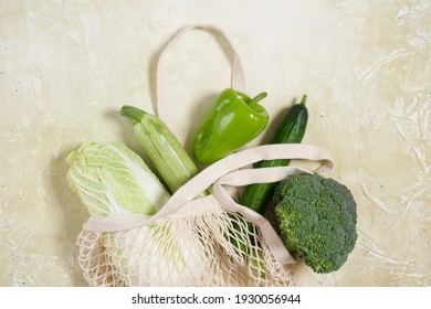 fresh vegetables in eco friendly reusable shopping bag .Zero waste lifestyle Plastic free concept Healthy food in mesh bag copy space top view