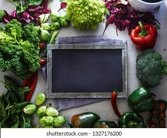 Fresh vegetables flatlay overhead frame.Blackboard with vegetables.. Food layout. Diet. Dieting plan
