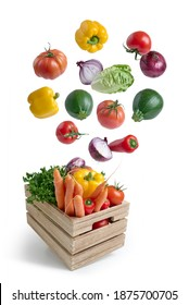 Fresh vegetables flying in a wooden box isolated from white background