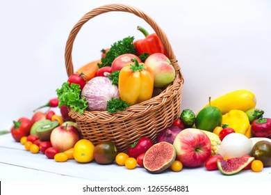 Fresh vegetables and fruit in basket isolated on white. 