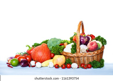 Fresh vegetables and fruits in a basket. Copy space.