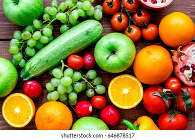 fresh vegetables and fruits for fitness dinner on wooden background top view