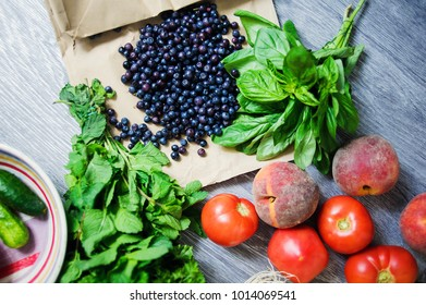 Fresh vegetables and fruits from market on the gray background. Summer and healthy life concept. Top view, selective focus.