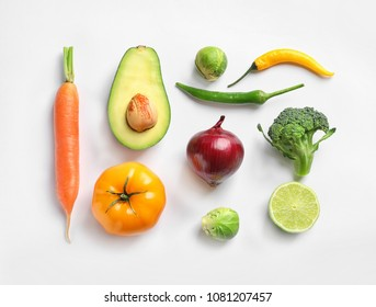 Fresh vegetables and fruits on white background, top view