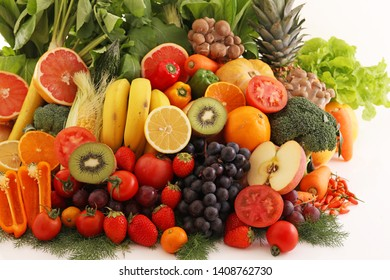 Fresh vegetables and fruits on white background.