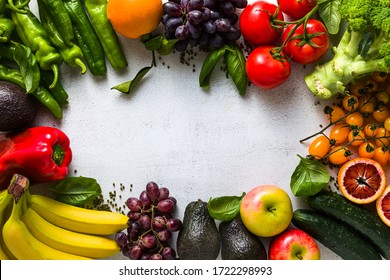 Fresh vegetables and fruits on a white kitchen table. Background for supermarkets, fresh food stores, delivery.
