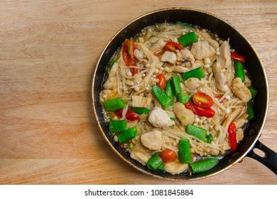 Fresh vegetables in a frying pan. Fresh vegetable products, freshly frozen odietic vegetables, broccoli, corn, asparagus, pepper, carrots are cooked in a frying pan on a gas stove