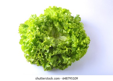 Fresh vegetables, garlic and leaf lettuce. Isolated on white background. Selective focus.