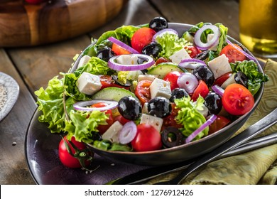 Fresh vegetables greek salad . Healthy food on wooden background