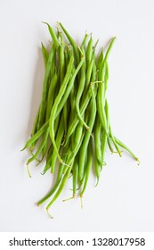 Fresh vegetables, green beans on a white background top view