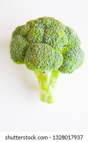 Fresh vegetables, green broccoli on a white background top view