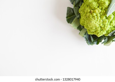 Fresh vegetables, green cauliflower on a white background top view