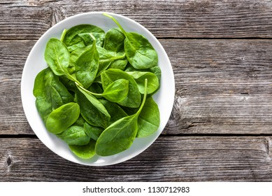 Fresh vegetables, green spinach on plate, vegetarian food and healthy eating concept