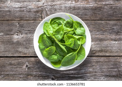 Fresh vegetables, green spinach on plate, healthy diet, vegetarian food concept