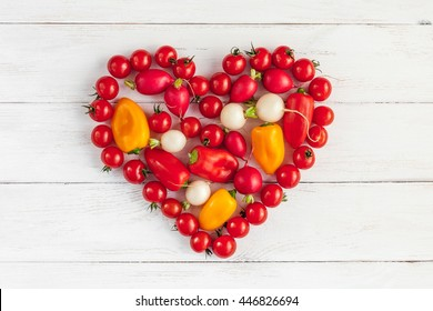 Fresh vegetables in a heart shape. Ingredients for vegetable salad. Top view, flat lay