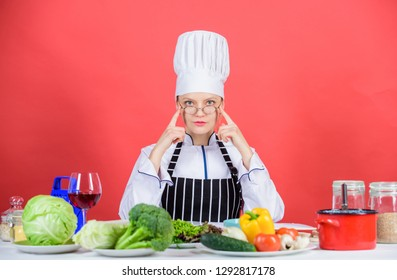 Fresh vegetables ingredients for cooking meal. Culinary school concept. Female in apron knows everything about culinary art. Culinary education. Culinary expert. Woman chef cooking healthy food.