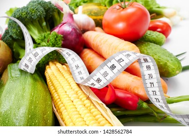 fresh vegetables with measuring tape