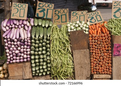 Fresh vegetables neatly stacked and priced at the main vegetable market in Colombo, Sri Lanka