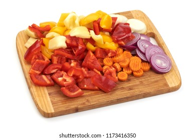 Fresh vegetables on cutting board isolated on white background.