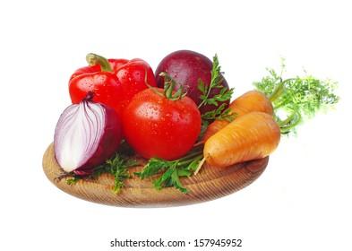 Fresh vegetables on the kitchen board. White background