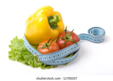 fresh vegetables on a list of a salad binded with blue measure tape