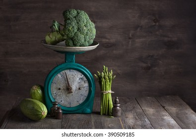 Fresh vegetables on the old vintage scales on wooden background