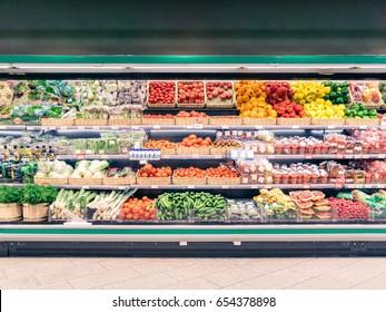 Fresh vegetables on shelf in supermarket for background
